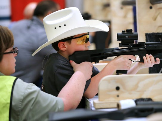 Aaron Simpson, 8 of Sidney, Ohio, lines up a shot as