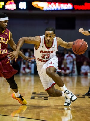 UL Ragin' Cajuns guard Tiremone Williams (23) drives the ball toward the goal during a college basketball game against the Loyola Wolf Pack at the Cajundome in Lafayette, La., Wednesday, Nov. 25, 2015.
