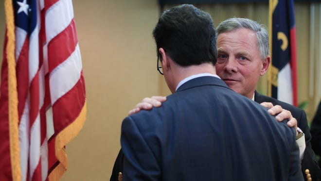 Republican U.S. Senator Richard Burr has a word with an unidentified man attending the Buncombe County Republican Party's Lincoln-Reagan Dinner Saturday. Colby Rabon/ colbyrabon@gmail.com