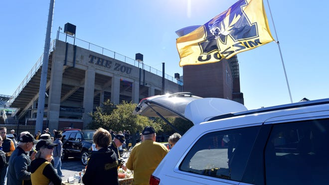 Fans tailgate in the parking lots before a game between Missouri and Memphis on Oct. 20, 2018, at Memorial Stadium.