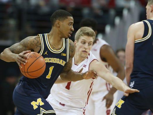 Feb. 11: Michigan guard Charles Matthews works the