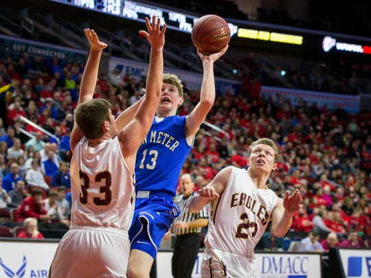 Van Meter's (13) Jack Trudo shoots around Pella Christian's