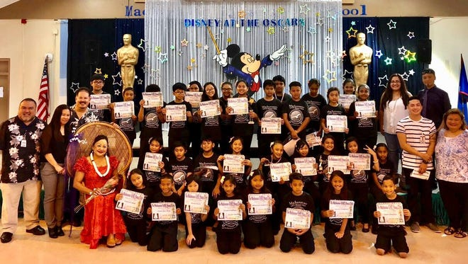 Machananao GATE Honor Choir in action with special guest artist Flora Baza Quan, on April 6. Pictured with the choir is Mr. Sanchez, Deputy Superintendent of Curriculum and Instruction; Mrs. Quejado, Machananao Elementary Principal; Mr. LaPlante, GATE Music Specialist; Miss Flora Baza Quan, Guest Artist; Mrs. Divina Leones-Tumanda , School Program Consultant; Mr. Candaso, GATE Program Coordinator; Mr. Medina, GATE Dance Specialist; and Mrs. Babauta, Machananao PTO Treasurer. Not shown is Mrs. Rivera, Machananao GATE Instructor