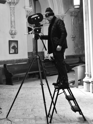 "Director L. Steven Stanley films a scene for ""The Train"" in St. Anne's Church in Fall River."