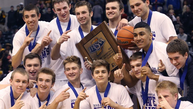 Guerin Catholic High School celebrates after defeating Griffith 62-56 in the state finals to win the IHSAA Class 3A Boys State Basketball Championship at Bankers Life Fieldhouse in Indianapolis on Saturday, March 28, 2015.