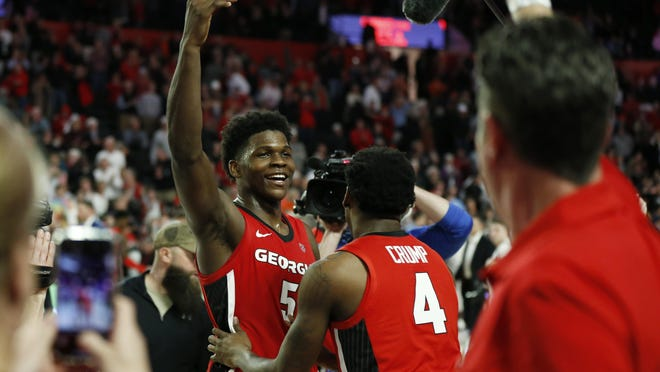 Georgia's Anthony Edwards (5) celebrates with fans after winning in a NCAA basketball game between Auburn and Georgia in Athens, Ga., on Wednesday, Feb. 19, 2020. Georgia won 65-55.