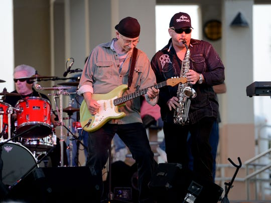 In this file photo, guitarist Eddie Parker and saxophonist Rick Hall, with After Midnight, perform for the crowd at the Gulfside Pavillion on Pensacola Beach during the first Bands on the Beach for the season.