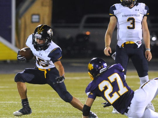 Stephenville running back Krece Nowack, left, makes a cut during the Yellow Jackets' loss to Wylie last season at Bulldog Stadium.