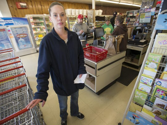 Lindsey Cox, night manager at Heartland Market in Greentown, says she has switched to bottled water because of the lead scare in her town.
