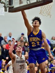 Waynesboro's Jay Alverez goes up for a rebound after a shot by Shippensburg's Carter Van Scyoc. Shippensburg hosted Waynesboro in basketball on Tuesday, January 2, 2018.