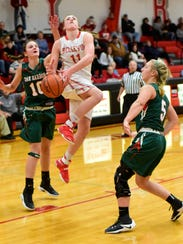 Bellevue's Payton Vogel splits two Oak Harbor defenders
