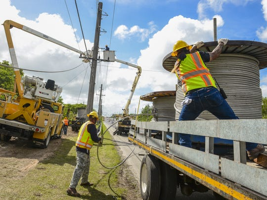 In this file photo, Guam Power Authority employees