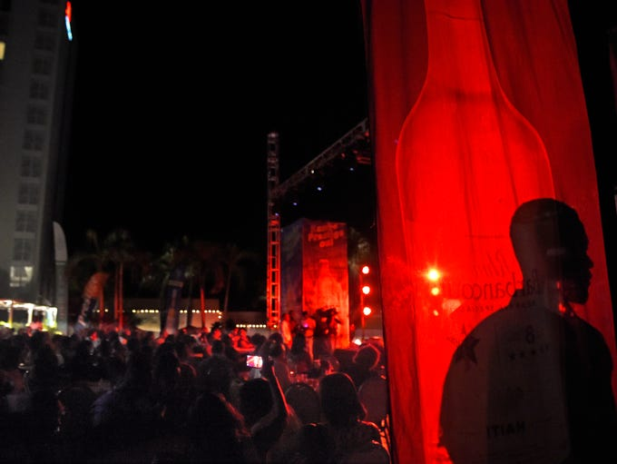 Guests dance to the music under the glow of stage lights