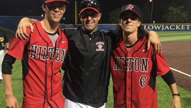 From left to right, Austin Metzger, Hilton coach Jeff Murphy and Alex Hendry pose for a picture after a senior all-star game at the University of Rochester last spring.