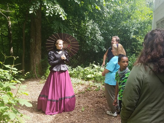 A member of the Winfield family, played by Lianna Brice, confronts our group on her families plantation, suspecting us of being abolitionists.