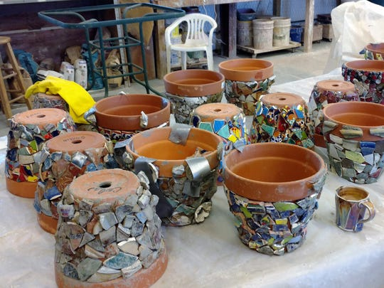Mosaic pieces are ready to be blended into the pots.
