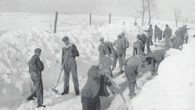 Removing snow by hand near Verona.