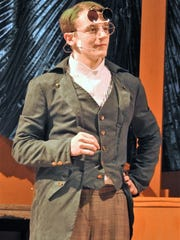 "Senior Cole Fisher plays Green Grasshopper in ""James"