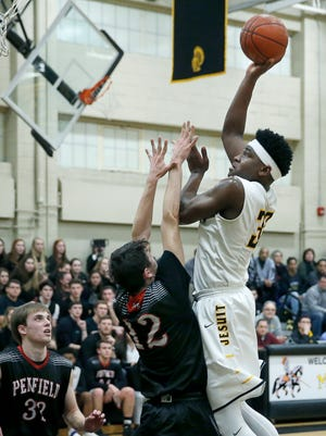 McQuaid's Isaiah Stewart aims at the basket over Penfield's Mirza Mesic in the second quarter at McQuaid Jesuit High School.