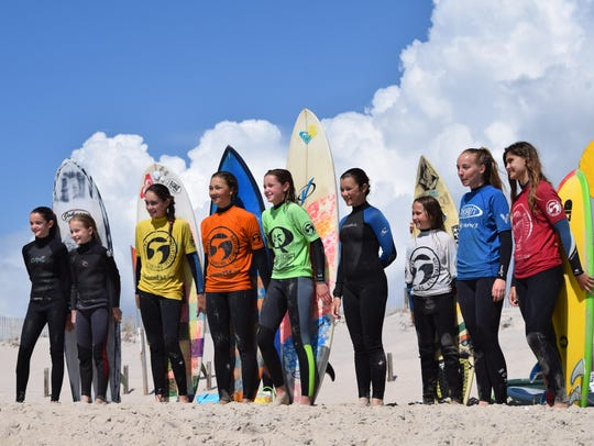 Competitors from the Girls Shortboard competition pose