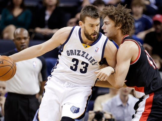 Memphis Grizzlies center Marc Gasol (33), of Spain, drives against Portland Trail Blazers center Robin Lopez in the first half of an NBA basketball game on Tuesday, March 11, 2014, in Memphis, Tenn. (AP Photo/Mark Humphrey)