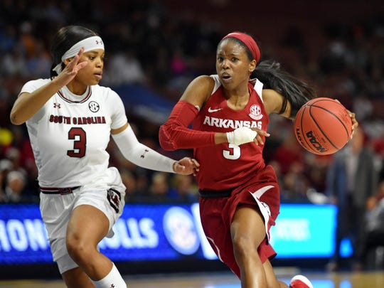 Arkansas' Malica Monk, right, drives while defended by South Carolina's Destanni Henderson during the first half of a women's Southeastern Conference NCAA college basketball tournament game Friday, March 8, 2019, in Greenville, S.C. (AP Photo/Richard Shiro)