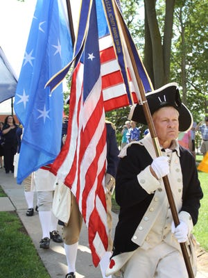 Members of the Michigan Society Sons of the American Revolution Color Guard presented the colors during a ceremony Friday at the Historic Howell Courthouse in downtown Howell. The ceremony was to recognize and honor Livingston County's fallen World War I servicemen.