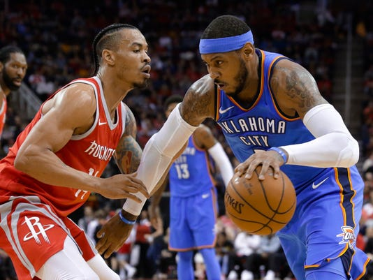 Oklahoma City Thunder forward Carmelo Anthony (7) looks to drive around Houston Rockets guard Gerald Green (14) during the first half of an NBA basketball game Saturday, April 7, 2018, in Houston. (AP Photo/Michael Wyke)