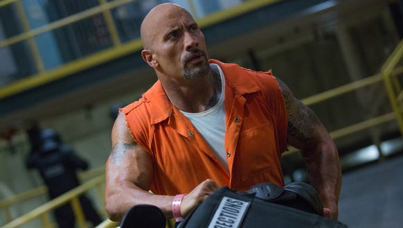 "Dwayne Johnson stars as lawman Luke Hobbs in ""The Fate of the Furious."""
