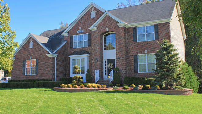 This four-bedroom, brick-front home at 19 Tall Oaks Drive in Monroe will be open 1 to 4 p.m. Sunday, Oct. 16.