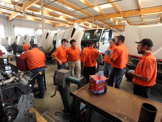 Students in the Ventura College diesel mechanics program train at the Gibbs International Truck Centers facility in Oxnard.