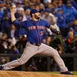 New York Mets pitcher Matt Harvey throws during the first inning of Game 1 of the Major League Baseball World Series against the Kansas City Royals Tuesday, Oct. 27, 2015, in Kansas City, Mo. (AP Photo/Matt Slocum)