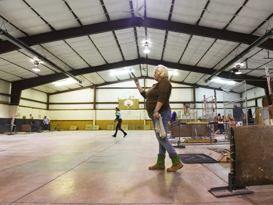 Stacy Green takes aim at Sarbaugh's Indoor Courts in Adamsville. The courts host monthly horseshoe tournaments.