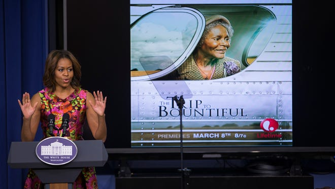 First Lady Michelle Obama gestures during remarks after a screening of the movie 'The Trip to Bountiful' in the South Court Auditorium on the White House complex on Feb. 24, 2014, in Washington, D.C.