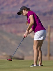 Kyla Smith from Desert Hills battles the wind on a