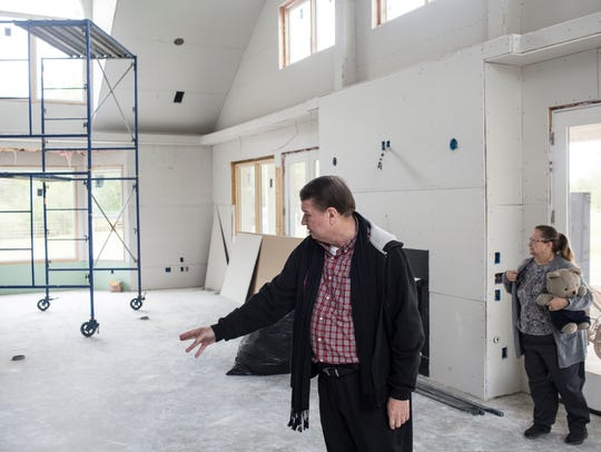 "April 19, 2018 - Joe Ennis shows off part of the 4,400-square-foot addition to his home that will have space for an office and a massive gathering room for the children and parents. Joe and Gayle Ennis bought their property on Springmont Trail in Collierville more than a decade ago and now it is where Joe will realize his dream of building Mark's Park, a special ""humorous"" nature park built exclusively for children and adults with autism."