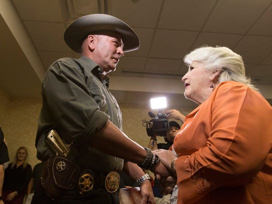 Clay Higgins greets supporter Verna Henderson following