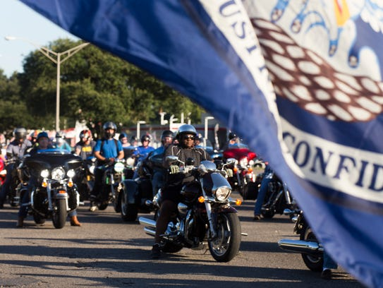 The Louisiana flag flies as bikers travel during in