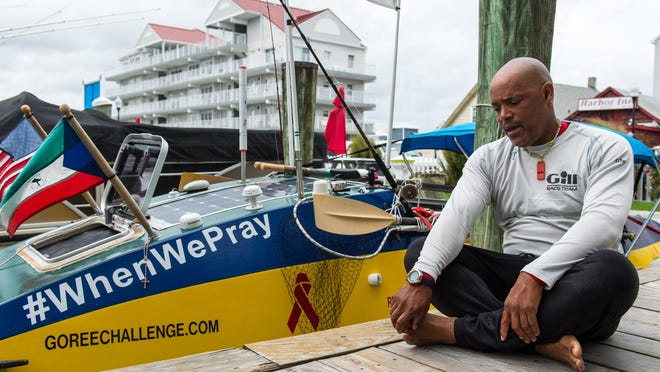 Victor Mooney shares his story of crossing the Atlantic Ocean at the White Marlin Marina on Monday afternoon. After three failed attempts crossing the Queens, New York native is in the final stretch of his voyage in memory of those who have died of AIDS.