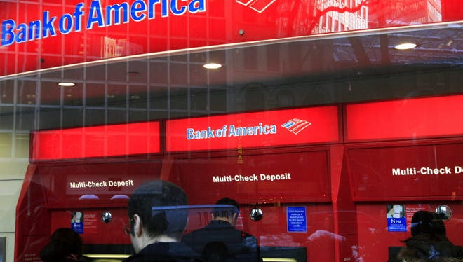 Bank of America customers use ATM machines in New York.