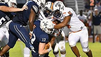 Siegel QB Brendan Crowell is sacked by the Blackman defense including #5 Alec Patton on Friday, September 15, 2017.