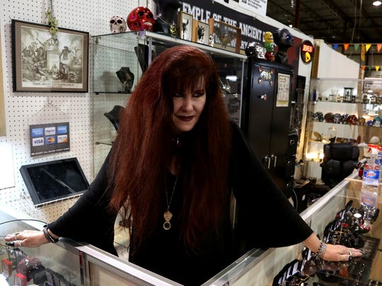 Cindy Fleming of Oxford, Michigan at her Temple of the Ancient Dragon booth at the Gibraltar Trade Center in Mt. Clemens on Friday, September 12, 2014.  The booth closed earlier this year after the business put more emphasis on online sales.