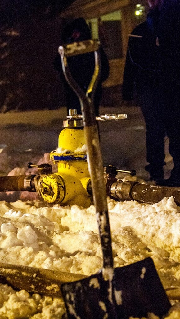 Rochester firefighters had to dig this hydrant out Friday night before they could fight a house fire. That's an extra five minutes of valuable time