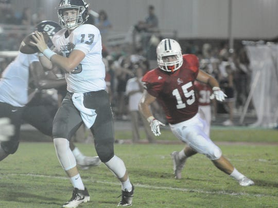 Siegel's Brendan Crowell fires a first-half pass Friday at Cookeville.