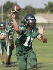 Andrew Valdez passes during El Diamante football practice on Tuesday, August 23, 2016.