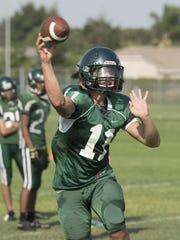 Andrew Valdez passes during El Diamante football practice