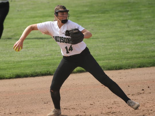 Madison's Mackenzie Mullins throws the ball to first