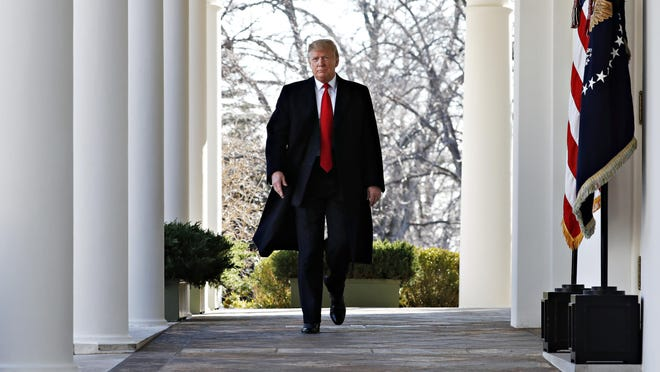 President Donald Trump walks through the Colonnade from the Oval Office of the White House as he arrives to announce a deal to temporarily reopen the government, Friday, Jan. 25, 2019, from the Rose Garden of the White House in Washington. (AP Photo/Jacquelyn Martin)