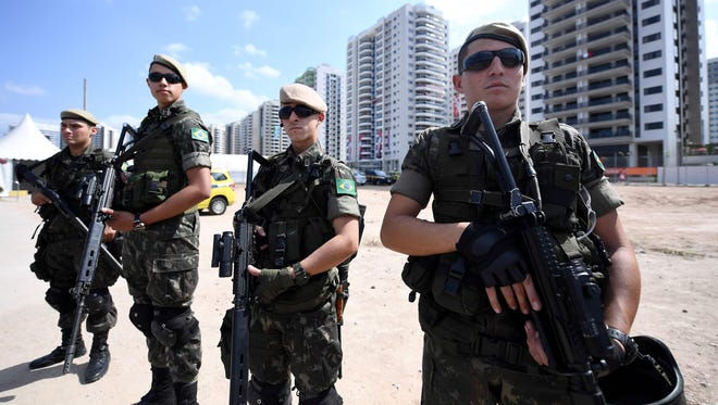 Brazilian soldiers stand guard near the Olympic Village in Rio de Janeiro, on Thursday, Aug. 4, 2016.