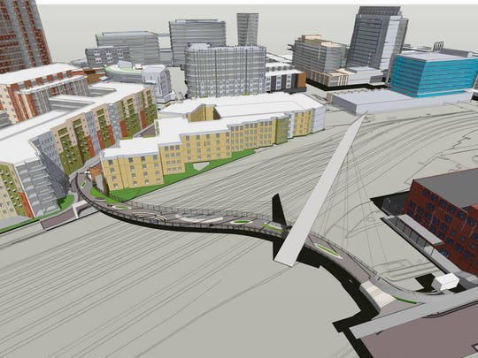 A rendering shows how a 700-foot pedestrian bridge would connect the Gulch to the SoBro area of downtown.